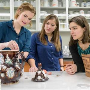 Leah Bright, Sam Owens, and Madeline Corona discuss the treatment of a ceramic