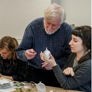 Lia Kramer learning to rejoin ceramics from Steve Koob