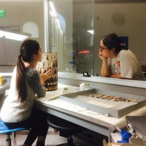 Alyssa Rina discusses a treatment with a visitor In The Artifact Lab, Penn Museum, Philadelphia