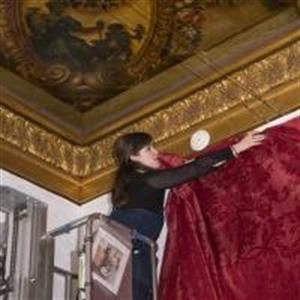 Caite Sofield installs fabric paneling in a gallery  (Courtesy of the Philadelphia Museum of Art by Jason Wierzbicki)
